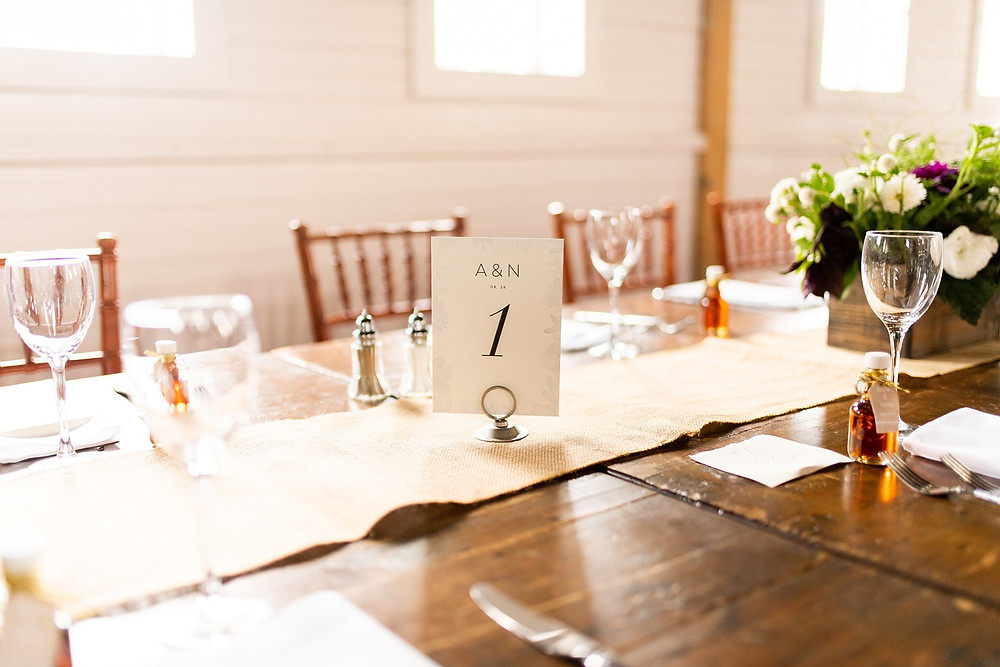 table number on rustic table at reception venue