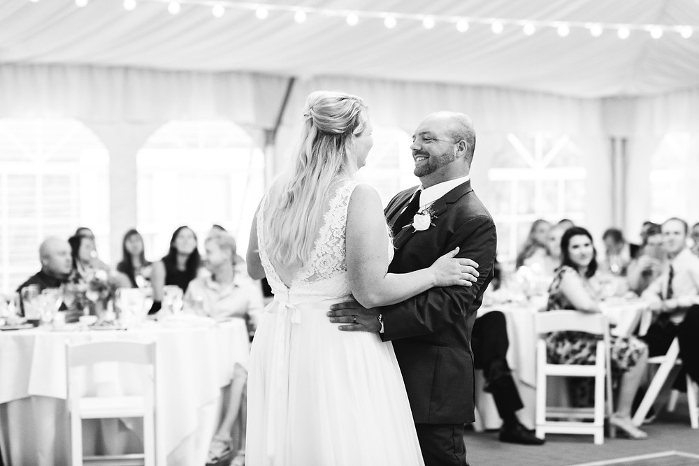 bride and groom smile during their first dance