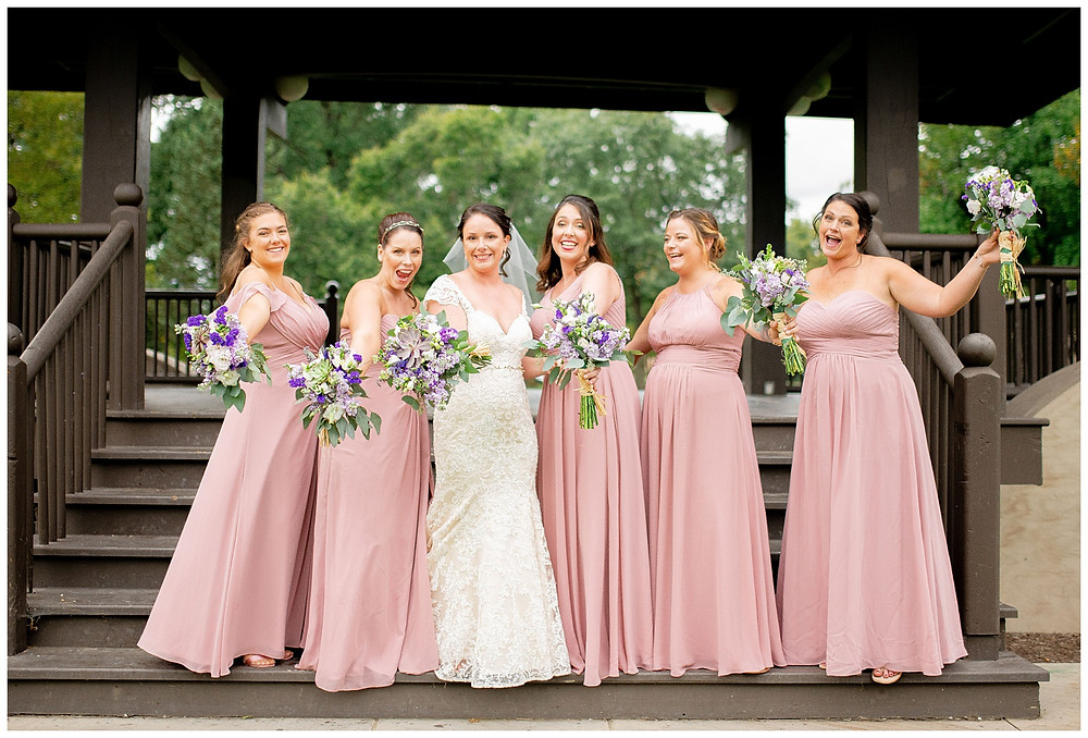 bride and bridesmaids show off their flowers near Cleveland Ohio