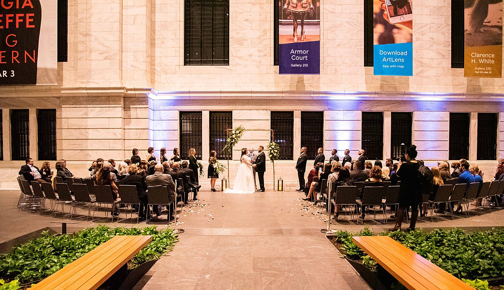 wedding ceremony takes place at the cleveland museum of art atrium