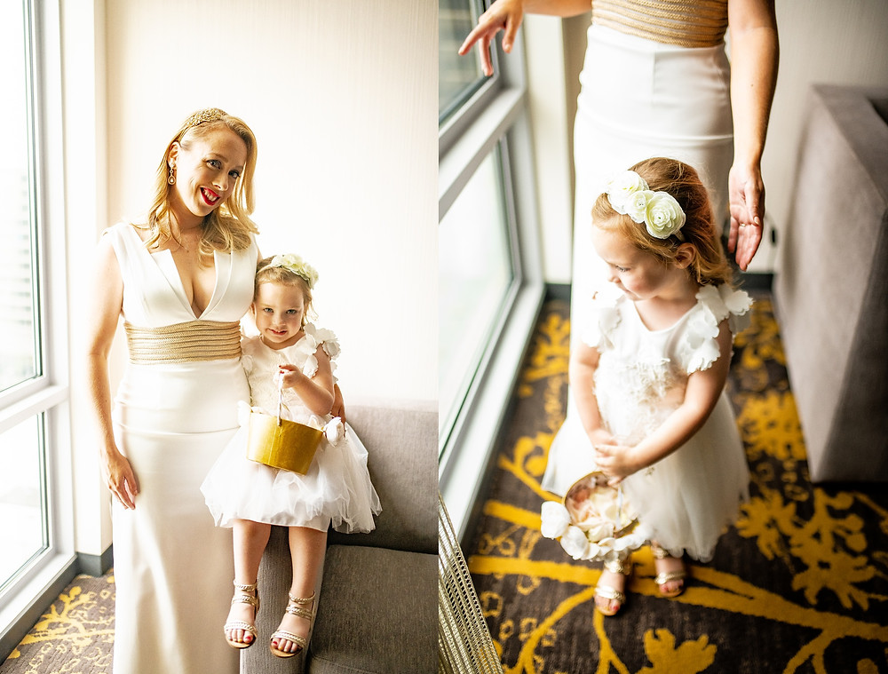 Bride and flower girl smile on her wedding day at the Westin Cleveland