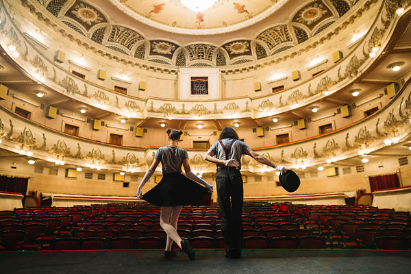 two-mime-artist-bowing-stage-auditorium_