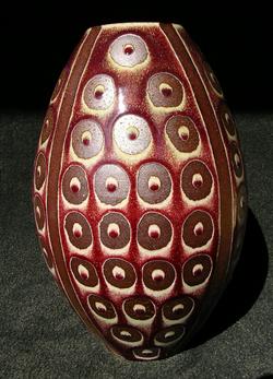 Resist decorated red vase.