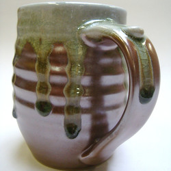 Clay and ash tankard.