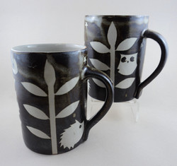 Resist mugs with owls and hedgehog.
