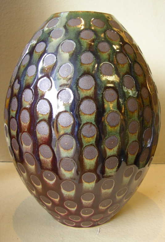 Resist-decorated dotty vase.