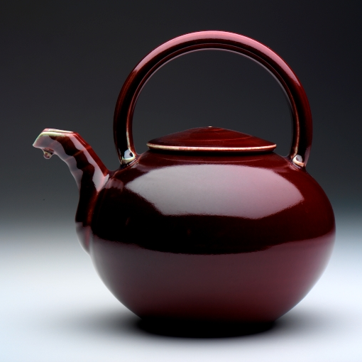 Red teapot-overtop handle.