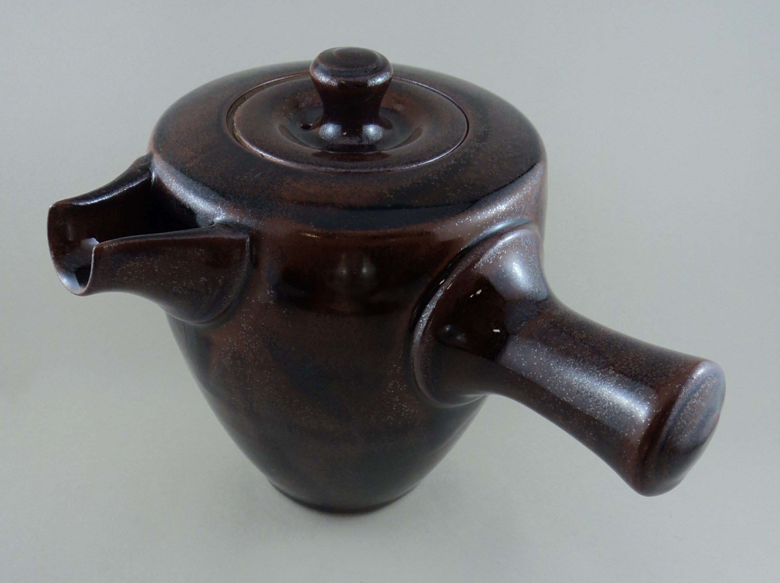 Side handled tenmoku teapot.