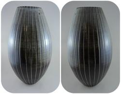 Vase with carved stripes.