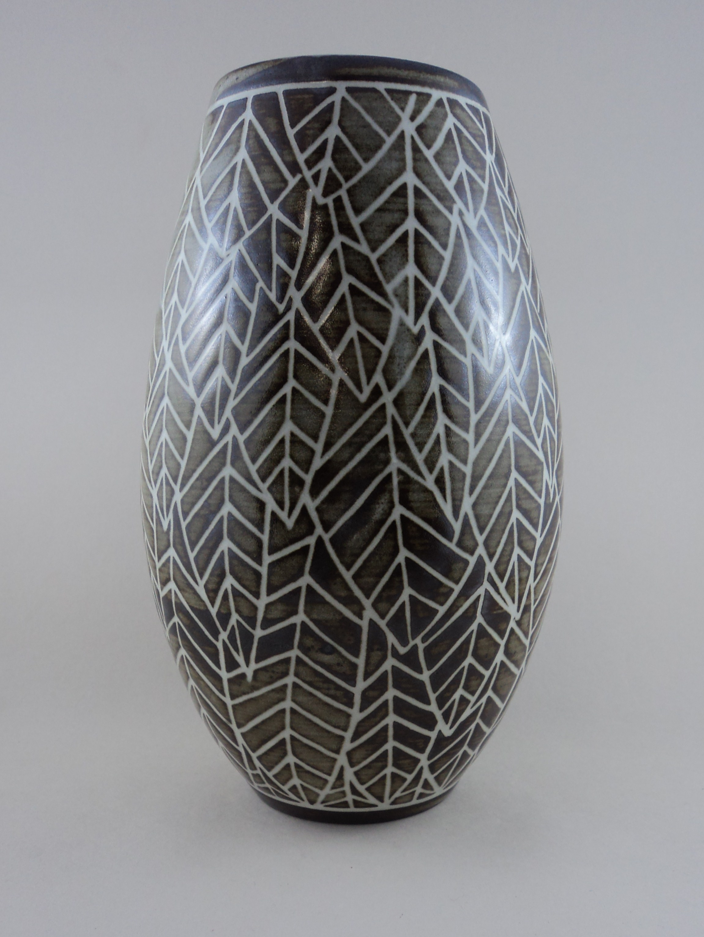 Vase with carved leaf pattern.