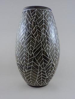 Vase with carved leaf pattern.