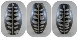 Resist-decorated, three-sided vase.