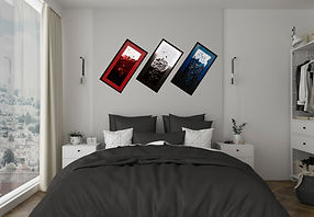3 framed custom abstract acrylic paintings above a bed.