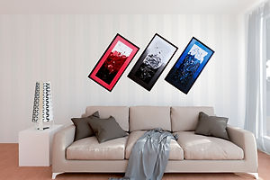 3 framed custom abstract acrylic paintings above a sofa.