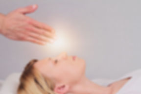 Attractive young woman having reiki heal