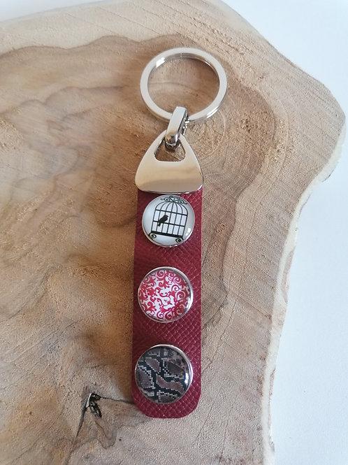Porte-clefs cabochons sur cuir grainé bordeaux