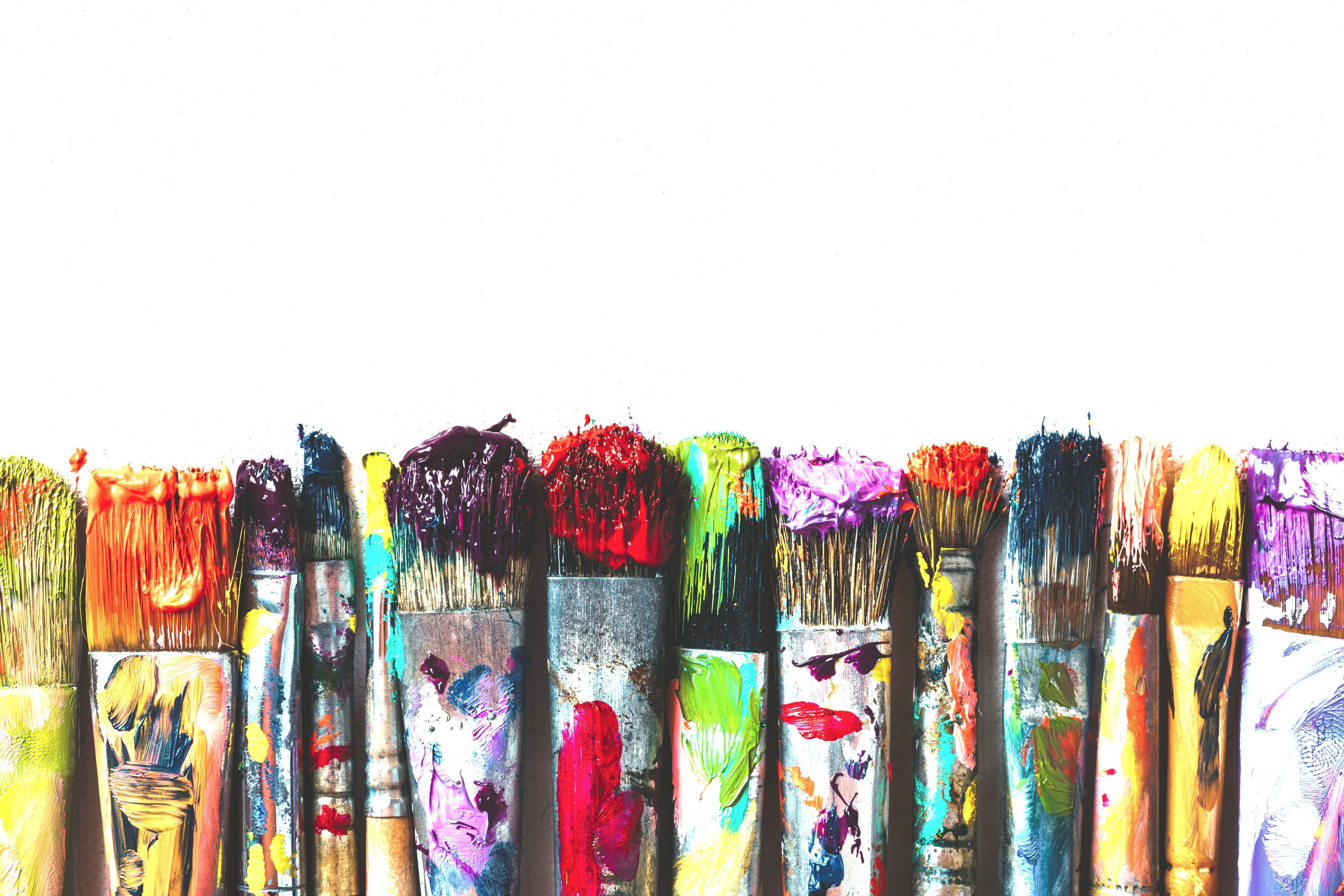 Row of artist paintbrushes closeup on ar