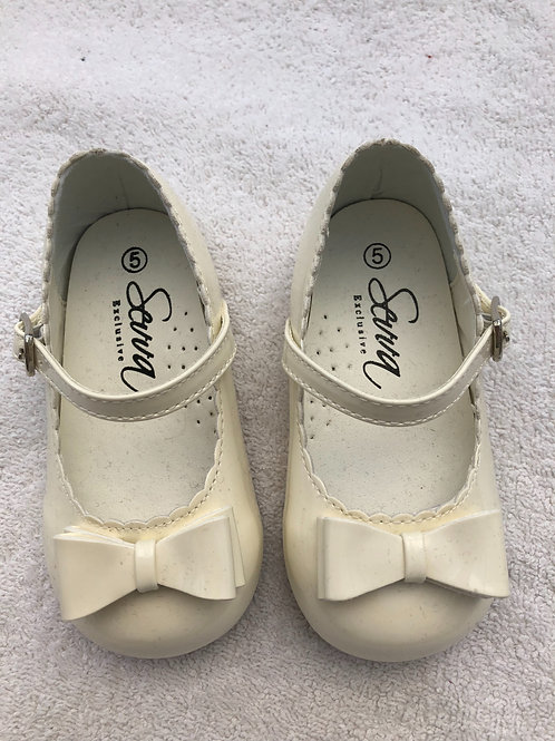 Cream patent shoes by Sevva