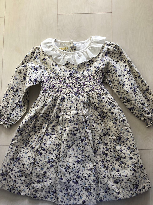 Cream and lilac smocked dress