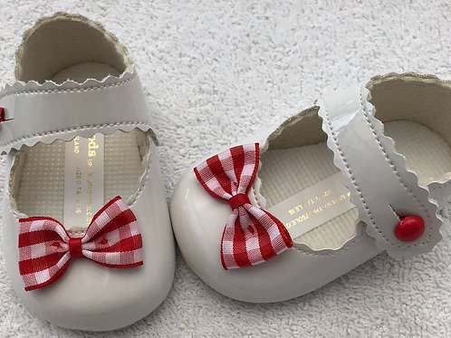 White patent baby shoes with red gingham bow