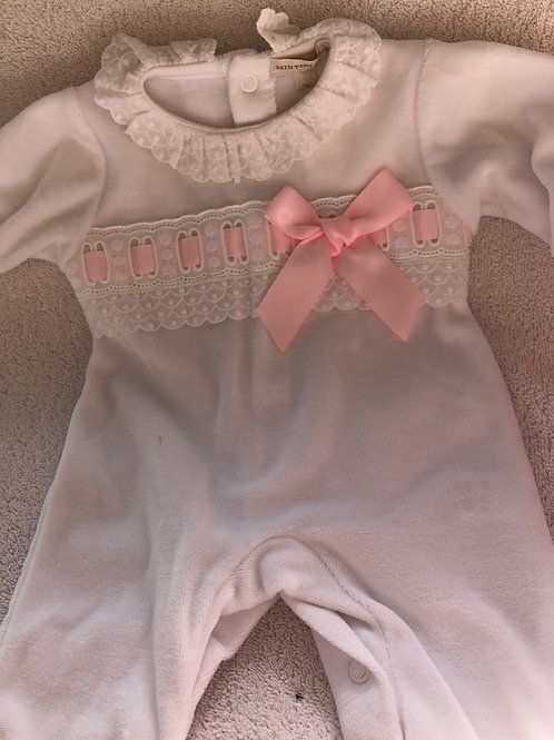 White sleepsuit with lace and ribbon