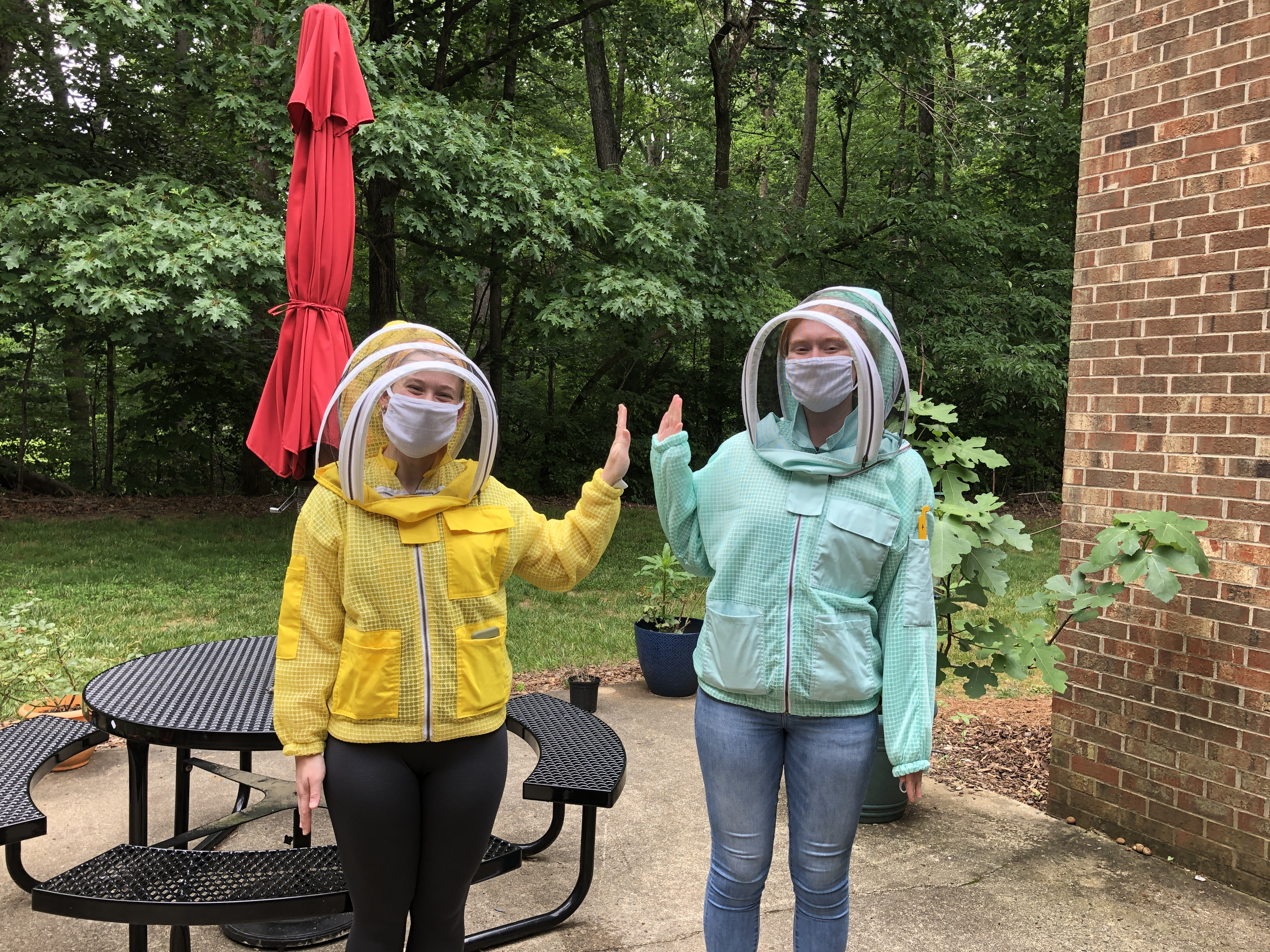 Meg and Lexi in their new bee suits!