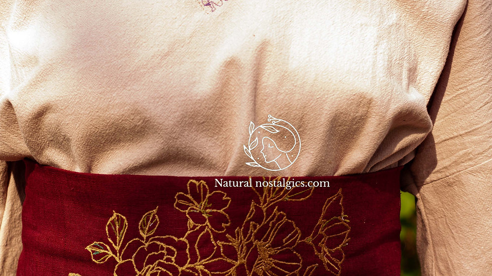 Embroidered burgundy red linen waist belt with a lace corset closing system to a