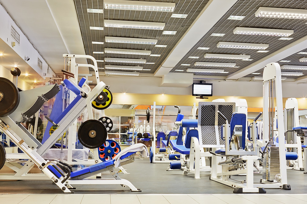 Fitness center with traineger equipments.jpg