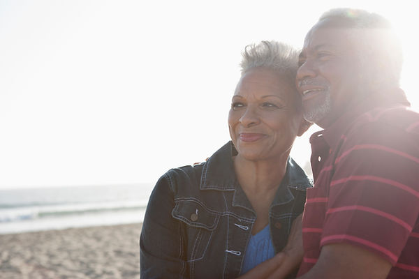 Happy African American Couple standing on a beach