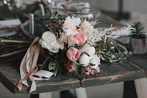 rustic bouquet on green wooden table 448