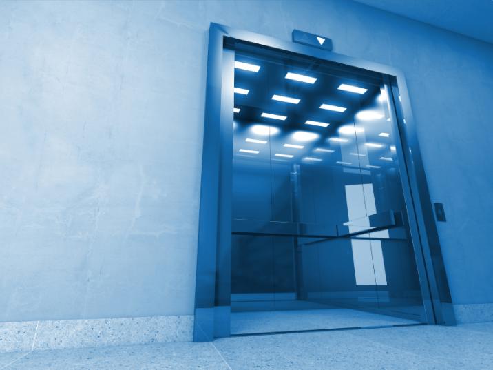Elevator with doors open blue lighting