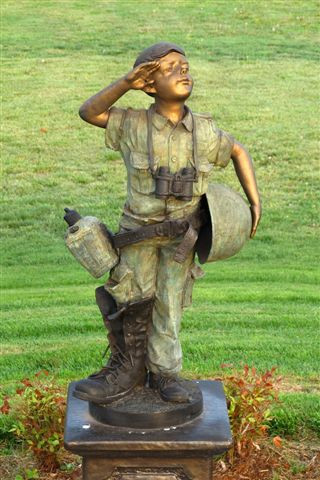 Patriotic Boy: In memory of the spouses of military veterans and Sara Gonzalez Coffey who have kept the home fires burning.