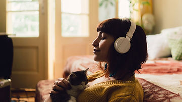 woman-meditating-with-headphones.jpg
