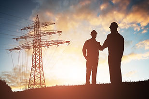 Silhouette Of Two Engineers Shaking Hand