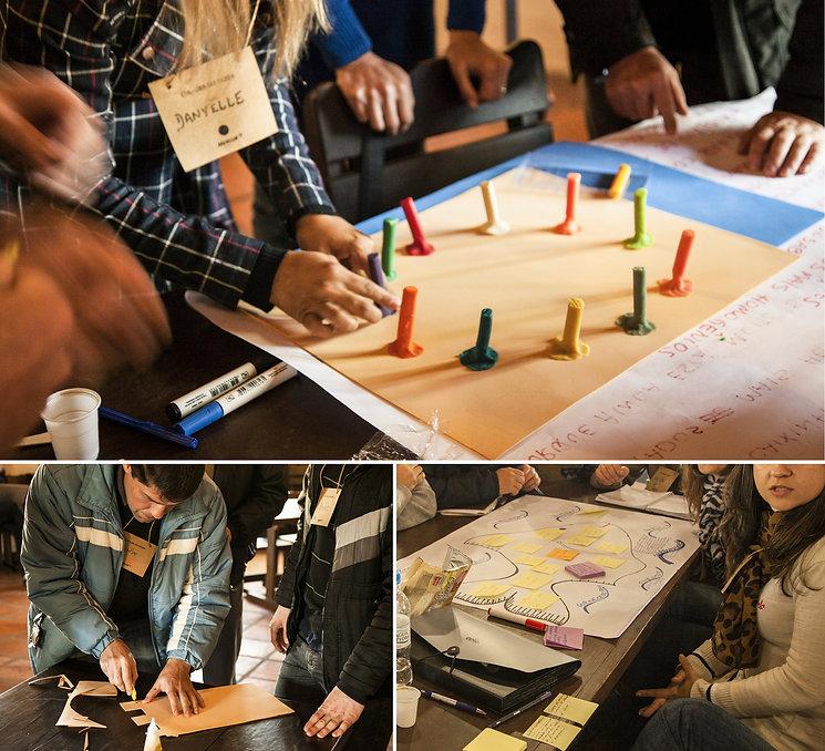 Workshop de cocriação com os colaboradores. Pessoas manipulam massa de modelar e papelão em cima de mesas.