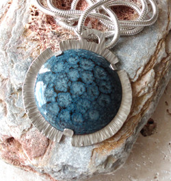 Enamelled cabochon in silver setting