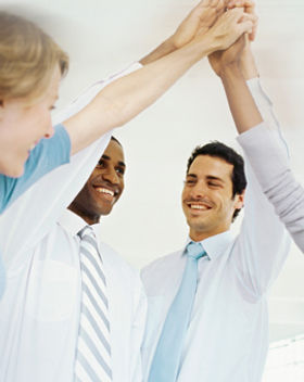 Team of five employees giving a High Five