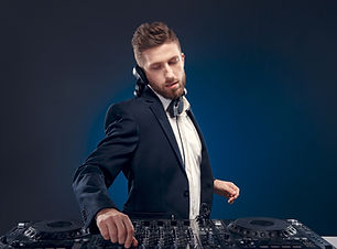 Man DJ in dark suit play music on a Dj's