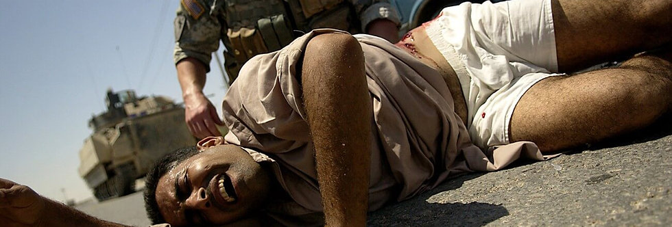 Wounded, Ramadi, Iraq. August, 2006.