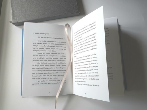 good open book with silver book no hand.