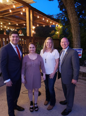 Eric Mahroum with his wife Holly and Judge Chris Gregory with his wife Ashley.