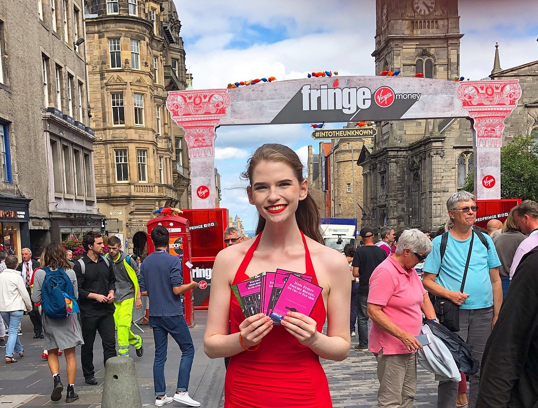 "Joan Milburn promoting ""The Texas Beauty Pagent Murder"" on the Royal Mile at the Edinburgh Fringe Festival"