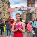 Joan Milburn handing out flyers for the show on the Royal Mile in Edinburgh, Scotland.
