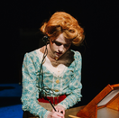 Henrietta writing a letter to Peter.