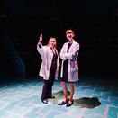 Joan Milburn as Dr. James and Rebekkah Sheridan as Toby Sealey examining MRI projections in Act I.