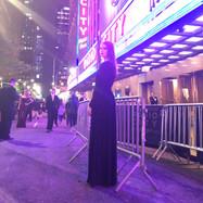 Joan Milburn posing outside of Radio City Music Hall after the Tony Awards.