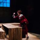 Paulinka stabbing Agnes's table in Act II.