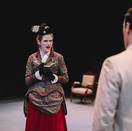 Lady Bracknell questions Jack Worthing in Act I.