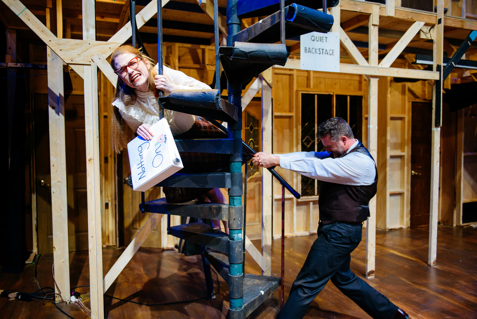 "Joan Milburn as Poppy Norton-Taylor and Scott Galbreath as Lloyd in ""Noises Off"" at Southwestern University"