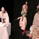 Desdemona, Biana, and Emilia sing together.